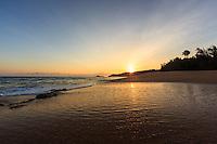 Sunrise reflected in rippling waters of Secret Beach (or Kauapea Beach), North Kaua'i.