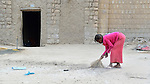 A girl sweeps the street in front of a house early in the morning in Timbuktu, the northern Mali city that was seized by Islamist fighters in 2012 and then liberated by French and Malian soldiers in early 2013. During the jihadis' rule, girls and women could not appear in public unless they were completely covered.