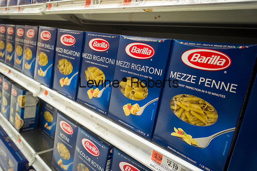 Boxes of Barilla pasta are seen on supermarket shelves in New York on Sunday, September 29, 2013. Guido Barilla remarked during an interview on Italian radio that the company would never make an ad with a homosexual   family and if gays don't like it they can eat another brand, prompting calls for a boycott of the company. Barilla has since apologized for the comment. (© Richard B. Levine)