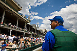 "Jim ""Jim Bob"" Douglas, who works on the starting crew at Churchill Downs, stops for a moment at the grandstands to take in the enormity of the Kentucky Derby. Start crews work seasonally and are busy during Triple Crown season which includes the Kentucky Derby."