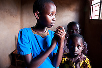 A group of Rwandan AIDS orphans in their home.