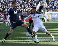 Carlos Valdes#5 of the Philadelphia Union moves the ball behind Greg Janicki#14 of the Vancouver Whitecaps during an MLS match at PPL Park in Chester, PA. on March 26 2011. Union won 1-0.