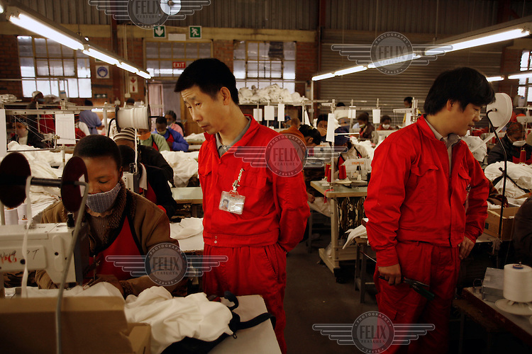 Taiwanese technicians at Precious Garment textile factory.