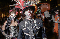 Donning Mexican Day of the DSead SPirit make up, a couple brave a chilly night to participate in the 41st Annual Halloween Parade. 10.31.2014. Photo by Marco Aurelio/VIEWpress