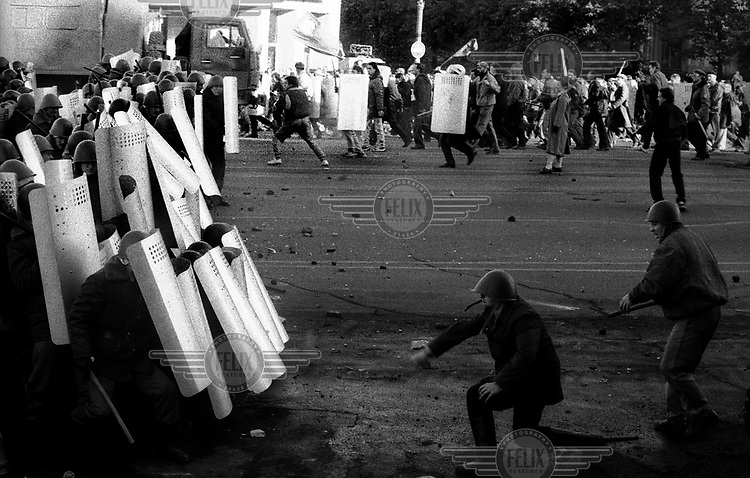 Protesters and militiamen clash during the August Putsch of 1991 which temporarily removed President Mikhail Gorbachev from power. The coup took place a day before the signing of the Unity Treaty which devolved power to the republics and preceded the break-up of the Soviet Union..
