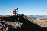 Female hiker enjoying view from near summit of Fan Brycheiniog in Black Mountain, Brecon Beacons national park, Wales