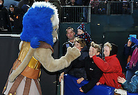 Bath Rugby mascot Maximus high fives young supporters at half-time. Aviva Premiership match, between Bath Rugby and Northampton Saints on December 5, 2015 at the Recreation Ground in Bath, England. Photo by: Patrick Khachfe / Onside Images