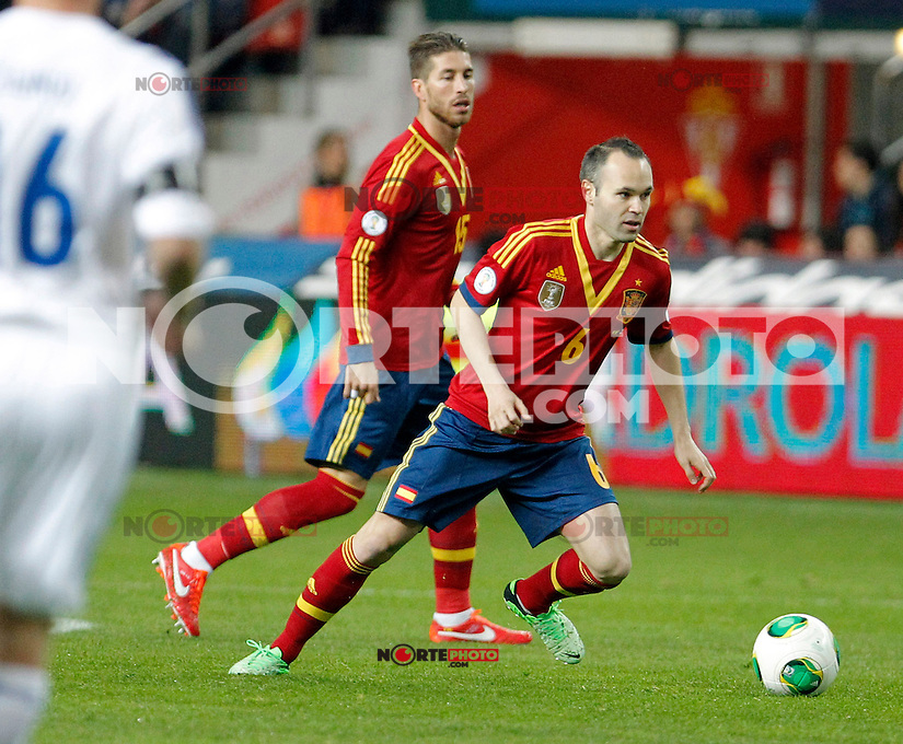 Spain's Andres Iniesta and Sergio Ramos during international match of the qualifiers for the FIFA World Cup Brazil 2014.March 22,2013.(ALTERPHOTOS/Victor Blanco)