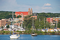 Sailboats lower harbor and downtown of Marquette Michigan.
