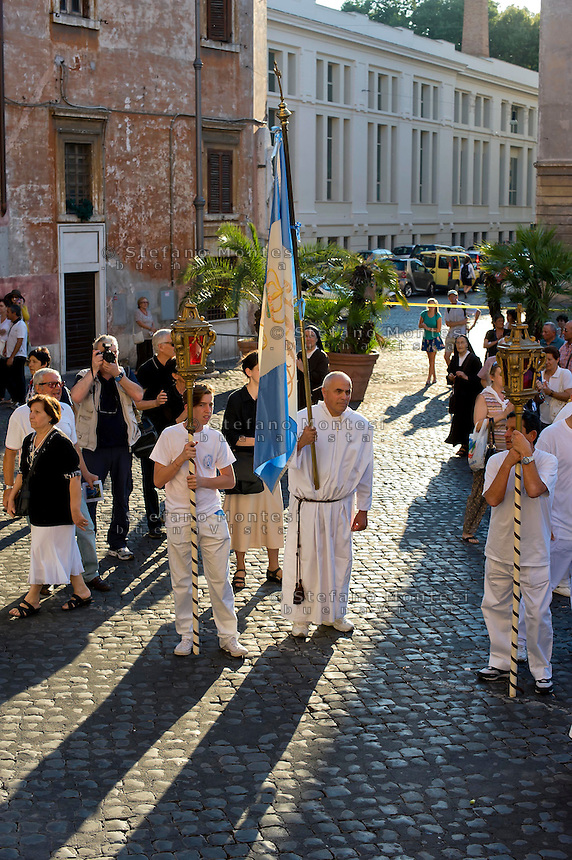 Roma 19 Luglio 2014<br /> Venerabile Arciconfraternita del SS.mo Sacramento e di Maria Ss. del Carmine in Trastevere a Roma fondata nell' anno 1539. I Solenni Festeggiamenti e la processione in onore della.Madonna del Carmine detta &quot;de' Noantri&quot;.<br /> Rome, Italy. 19th July 2014<br /> The Solemn celebrations and processions in honor of Madonna del Carmine, Our Lady of Roman Citizens, took place in Rome. The bearers of the statue were the Venerable Confraternity of the Blessed Sacrament and Maria del Carmine in Trastevere.