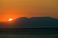 Sunset over Sleeping Lady mountain and the cook inlet, Anchorage, Alaska