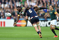 Tendai Mtawarira of South Africa offloads the ball after being tackled by Daniel Barrett of the USA. Rugby World Cup Pool B match between South Africa and the USA on October 7, 2015 at The Stadium, Queen Elizabeth Olympic Park in London, England. Photo by: Patrick Khachfe / Onside Images