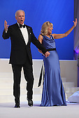 United States Vice President Joe Biden and Dr. Jill Biden wave goodbye after dancing during the Inaugural Ball at the Walter Washington Convention Center January 21, 2013 in Washington, DC. Biden and President Barack Obama started their second term by taking the Oath of Office earlier in the day during a ceremony on the West Front of the U.S. Capitol..Credit: Chip Somodevilla / Pool via CNP
