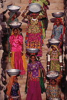 Dholavira Women workers on steps in trench.This society had incredibly sophisticated water systems..Women move dirt out of a giant reservoir just discovered this season in Dholavira. Mesopotamian cities drew water from rivers or irrigation canals but had no sophisticated drain system. 4,800 years ago, at the same time as the early civilizations of Mesopotamia and Egypt, great cities arose along the flood plains of the Indus and Saraswati (Ghaggar-Hakra) rivers. Developments at Harappa have pushed the dates back 200 years for this civilization, proving once and for all, that this civilization was not just an offshoot of Mesopotamia..They were a highly organized and very successful civilization. They built some of the world's first planned cities, created one of the world's first written languages and thrived in an area twice as large as Egypt or Mesopotamia for 900 years (1500 settlements spread over 280,000 square miles on the subcontinent)..There are three major communities--Harappa, Mohenjo Daro, and Dholavira. The town of Harappa flourished during this period because of it's location at the convergence of several trade routes that spanned a 1040 KM swath from the northern mountains to the coast.