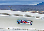 9 January 2016: South Korean pilot Yunjong Won leads his 4-man team as they cruise through Curve 14 during their second run of the day at the BMW IBSF World Cup Bobsled Championships at the Olympic Sports Track in Lake Placid, New York, USA. Won's team came in 14th for the day, with a 2-run combined time of 1:51.37. Mandatory Credit: Ed Wolfstein Photo *** RAW (NEF) Image File Available ***