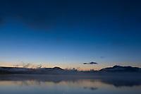 Moonrise over the Kejulik mountains and Naknek lake, Katmai National Park, Alaska.