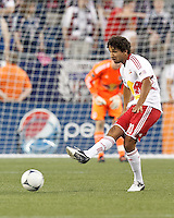 New York Red Bulls midfielder Mehdi Ballouchy (10) passes the ball. In a Major League Soccer (MLS) match, New England Revolution defeated New York Red Bulls, 2-0, at Gillette Stadium on July 8, 2012.