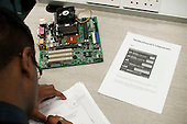 Examining a motherboard, Computer Studies class, Kingston College.