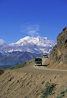 North and South peaks of Denali, (Mt. McKinley) north America's highest mountain, park tour buses on gravel park road, Denali National Park, Alaska