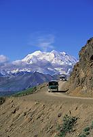 North And South Peaks Of Denali, North America's Highest Mountain, Park Tour Buses On Gravel Park Road, Denali National Park, Alaska