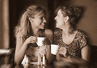 Women talking and laughing in outdoor cafe