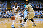 18 November 2015: North Carolina's Nate Britt (0) and Wofford's Derrick Brooks (1). The University of North Carolina Tar Heels hosted the Wofford College Terriers at the Dean E. Smith Center in Chapel Hill, North Carolina in a 2015-16 NCAA Division I Men's Basketball game. UNC won the game 78-58.