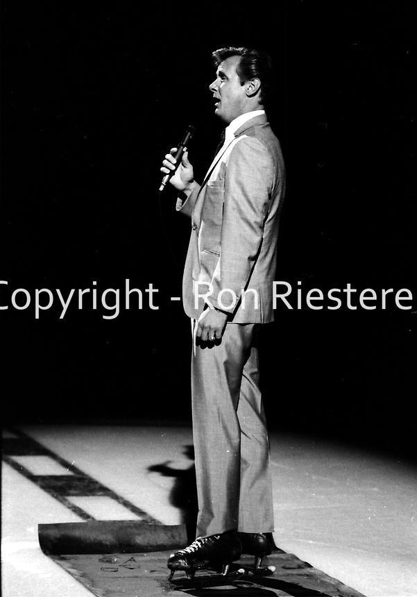 Singer John Gary sings at the opening game for the California Golden Seals 1067 season opener against the Philadelphia Flyers. (photo/Ron Riesterer)