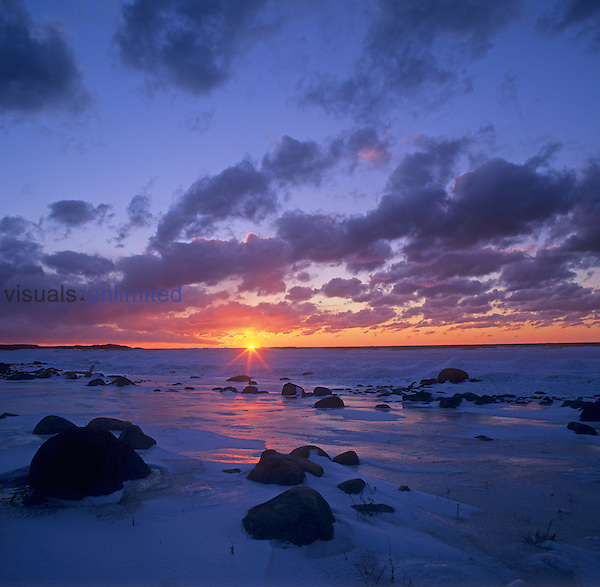 Winter sunset over Lake Michigan, Cat Head Point, Leelanau State Park, Michigan, USA.