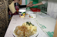 Woman are waiting for the second daily food distribution at the URiC Radom centre..While the Ramadan the woman collect the food and warm up later for the evening family meal..Per person for the midday meal: one leaf of cabbage with chicken meat and herbs, boiled potato, fried onion, soup, fruit juice, stewed apples for dessert and  bread..Polish personnel working in the kitchen have the list of refugees in the Centre. Each refugee should present his ID card to receive the daily food. This is a way to control who is the centre and who is absent..-For security reason, the face of the adult asylum seeker have been evicted of the photography..-For security reason, the names of the adult asylum seeker have been change. .-Article 9 of the Act of 13 June 2003 on grating protection on the Polish territory (Journal of Laws, No 128, it. 1176) personal data of refugees are an object of particular protection..-Cases where publication of a picture or name of asylum seeker had dramatic consequences for this persons and is family back in Chechnya. .Please have safety of those people in mind. Thank you.
