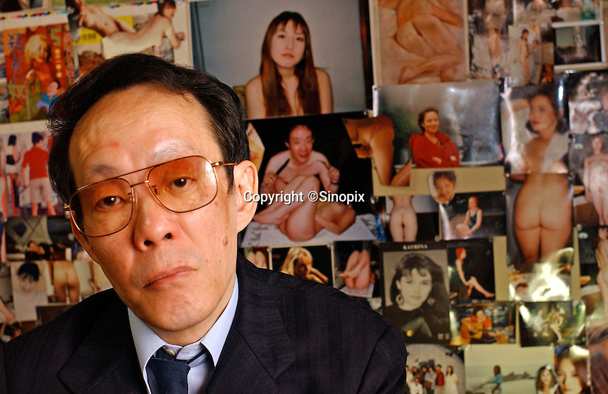 Issei Sagawa, the notorious Japanese cannibal, poses next to erotic photo collages in his bedroom. The collages contain images of Western and Asian  women he has dated and photographed. Sagawa killed and ate  Dutch student Renee Hartevelt while studying in Paris in 1981. He was released in Japan due to political connections after being jailed then placed in a mental institution in Paris. <br /> 14-DEC-05