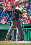 26 April 2014: MLB Umpire Doug Eddings tosses a ball to the pitcher during a game between the San Diego Padres and the Washington Nationals at Nationals Park in Washington, DC. The Nationals defeated the Padres 4-0 to take the third game of their 4-game series. Mandatory Credit: Ed Wolfstein Photo *** RAW (NEF) Image File Available ***