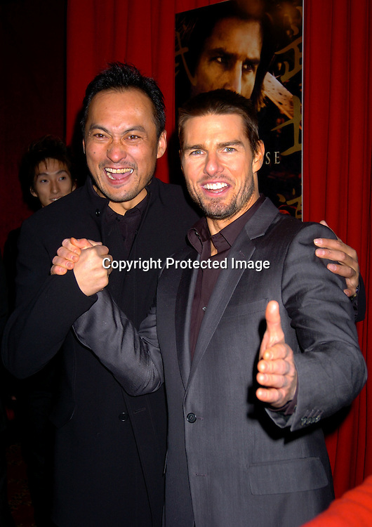 """Ken Watanabe and Tom Cruise..at the New York Premiere of """" The Last Samurai""""  on December 2, 2003 at the Ziegfeld Theatre.                           Photo by Robin Platzer, Twin Images"""