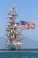 "The American flag trails from the stern of the USCG Training Barque ""Eagle"" as it makes its way through San Francisco Bay during the 2008 San Francisco Festival of Sail. The 295' Training Barque Eagle was originally constructed  in 1936 at the Blohm and Voss Shipyards in Germany with the purpose of training U-Boat crews. The United States took possession of the vessel in 1946 as part of Germany's reparations for the war and it is currently used by the Coast Gaurd for training of United States Coast Guard Academy Cadets. The Eagle is the only active commissioned sailing vessel in the United States' government service. Photographed 07/08"