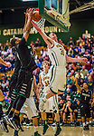 26 January 2014: University of Vermont Catamount Forward Clancy Rugg, a Senior from Burlington, VT, goes up to block a shot, as Forward Kurt Steidl (34), a Freshman from Ridgefield, CT looks on, during play against the Binghamton University Bearcats at Patrick Gymnasium in Burlington, Vermont. The Catamounts defeated the Bearcats 72-39 to notch their 12th win of the season. Mandatory Credit: Ed Wolfstein Photo *** RAW (NEF) Image File Available ***