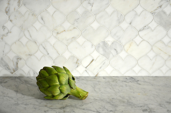 Hearts, a natural stone waterjet mosaic shown in polished Calacatta Tia and Thassos, is part of the Erin Adams Collection for New Ravenna Mosaics.<br /> Take the next step: prices, samples and design help, http://www.newravenna.com/showrooms/
