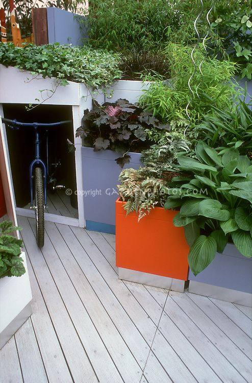 Container Garden Deck with moveable plant pots and hidden storage for a bicycle, in modern upscale colors and style