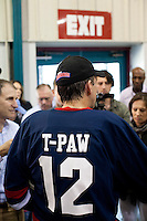 Republican presidential hopeful Tim Pawlenty talks to repoters after playing in a scrimmage hockey game during a campaign stop on Friday, July 22, 2011 in Urbandale, IA.