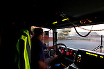 A view from inside the cab of a moving Fire Truck
