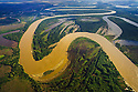 Bolivia, Beni Department, aerial view of  Mamore´ River winding through Amazonian rain forest and tree savannah; oxbow lakes; early morning
