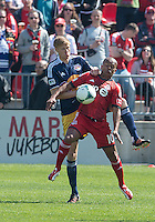 April 27, 2013: New York Red Bulls defender Markus Holgersson #5 and Toronto FC forward Robert Earnshaw #10 in action during a game between Toronto FC and the New York Red Bulls at BMO Field  in Toronto, Ontario Canada..The New York Red Bulls won 2-1.