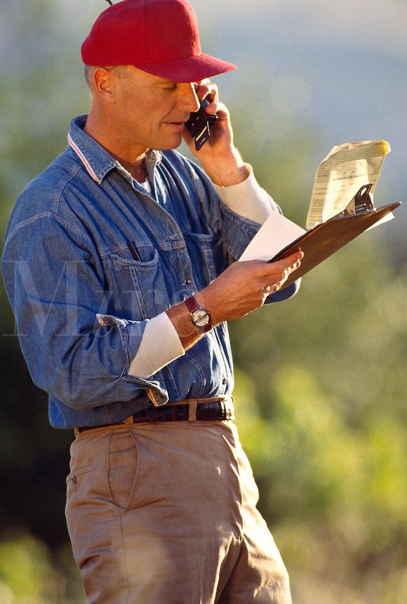 Farmer on mobile phone.