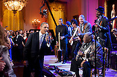 United States President Obama joins in singing Sweet Home Chicago during the In Performance at the White House: Red, White and Blues concert in the East Room of the White House, February 21, 2012. Participants include, from left: Troy Trombone Shorty Andrews, Jeff Beck, Derek Trucks,  B.B. King, and Gary Clark, Jr.  .Mandatory Credit: Pete Souza - White House via CNP