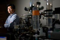 Ming Dao (left) and Sha Huang pose for a portrait at MIT in Cambridge, Massachusetts, USA. Using an optical setup and other equipment, the group investigates malaria and biomechanics of human and disease cells.  Dao is a principal research scientist in the Department of Materials Science and Engineering and a Principal Investigator in that Department and the Infectious Disease Interdisciplinary Research Group at MIT's SMART Center.