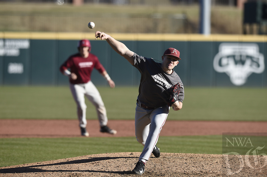 NWA Democrat-Gazette/MICHAEL WOODS @NWAMICHAELW<br /> University of Arkansas pitcher Kevin Koops fires a pitch Friday, January 27, during Razorback baseball teams first practice for the 2017 season at Baum Stadium.
