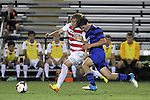 30 August 2013: Rutger's Dimitri Vassiliadis (left) and Duke's Zach Mathers (15). The Duke University Blue Devils hosted the Rutgers University Scarlet Knights at Koskinen Stadium in Durham, NC in a 2013 NCAA Division I Men's Soccer match. The game ended in a 1-1 tie after two overtimes.