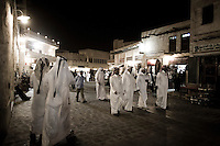 Qatar - Doha -  Qataris walking by in the old souk at night