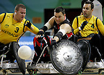 Mike Whitehead (centre) of Harrow, Ont. is defended by Ryley Batt (3) and Cameron Carr of Australia in Canada's 41 - 40 loss to Australia in wheelchair rugby semi-final action in Beijing during the Paralympic Games, Monday, Sept., 15, 2008.   Photo by Mike Ridewood/CPC