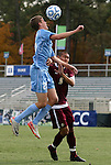 13 November 2011: North Carolina's Rob Lovejoy (25) heads the ball over Boston College's Patrick Chin (9). The University of North Carolina Tar Heels defeated the Boston College Eagles 3-1 at WakeMed Stadium in Cary, North Carolina in the Atlantic Coast Conference Men's Soccer Tournament championship game.