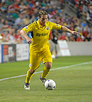 Columbus midfielder Chris Birchall (8) prepares to cross the ball.  The Chicago Fire defeated the Columbus Crew 2-1 at Toyota Park in Bridgeview, IL on June 23, 2012.