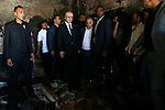 Palestinian Prime Minister Rami Hamdallah inspects the Dawabsheh home that was badly damaged from a suspected attack by Jewish extremists on two houses in the West Bank village of Douma near Nablus City, 31 July 2015. Suspected Jewish attackers torched a Palestinian home in the occupied West Bank on Friday, killing an 18-month-old toddler and seriously injuring three other family members, an act that Israel's prime minister described as terrorism. Photo by Ahmad Talat